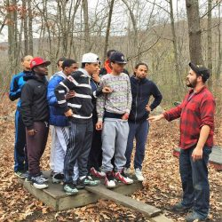 mens group gathered in forest