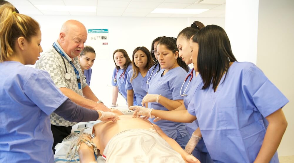 students participate in medical training