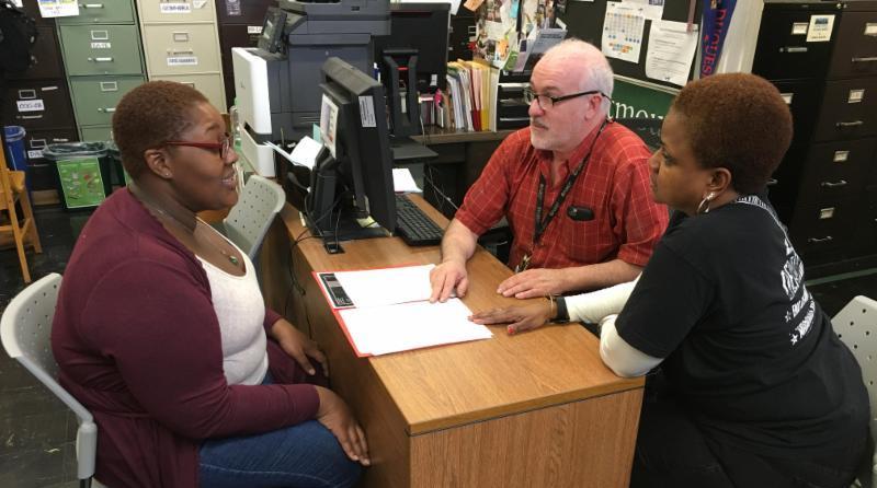 student presents math portfolio to teachers